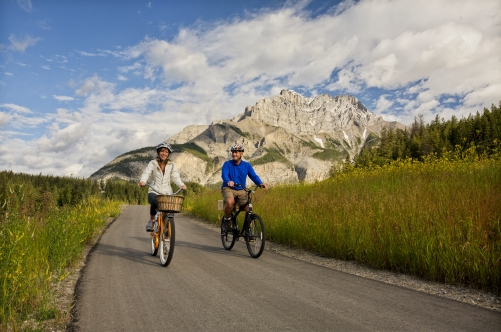 Cycling on the Banff Legacy Trail in Banff National Park, Alberta.